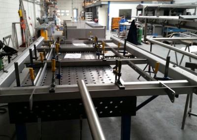 Samenstellen en aflassen RVS onderdeel van productielijn-Askom Techniek